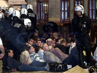 ENGLISH SOCCER FANS LIE ON STREET AFTER CLASHES WITH BELGIAN POLICE